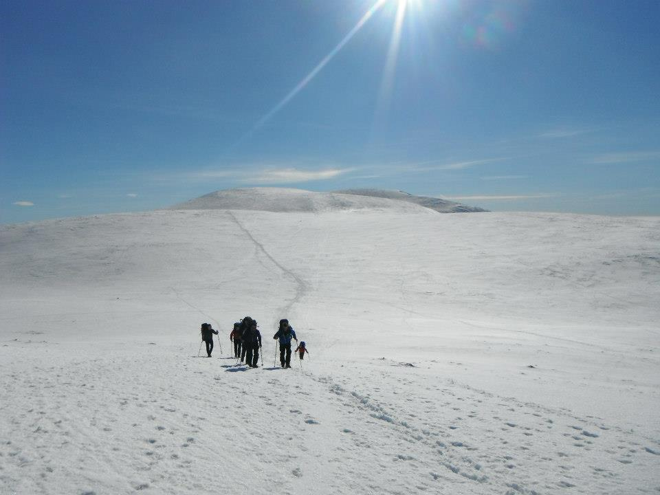 group of people walking in winter conditions
